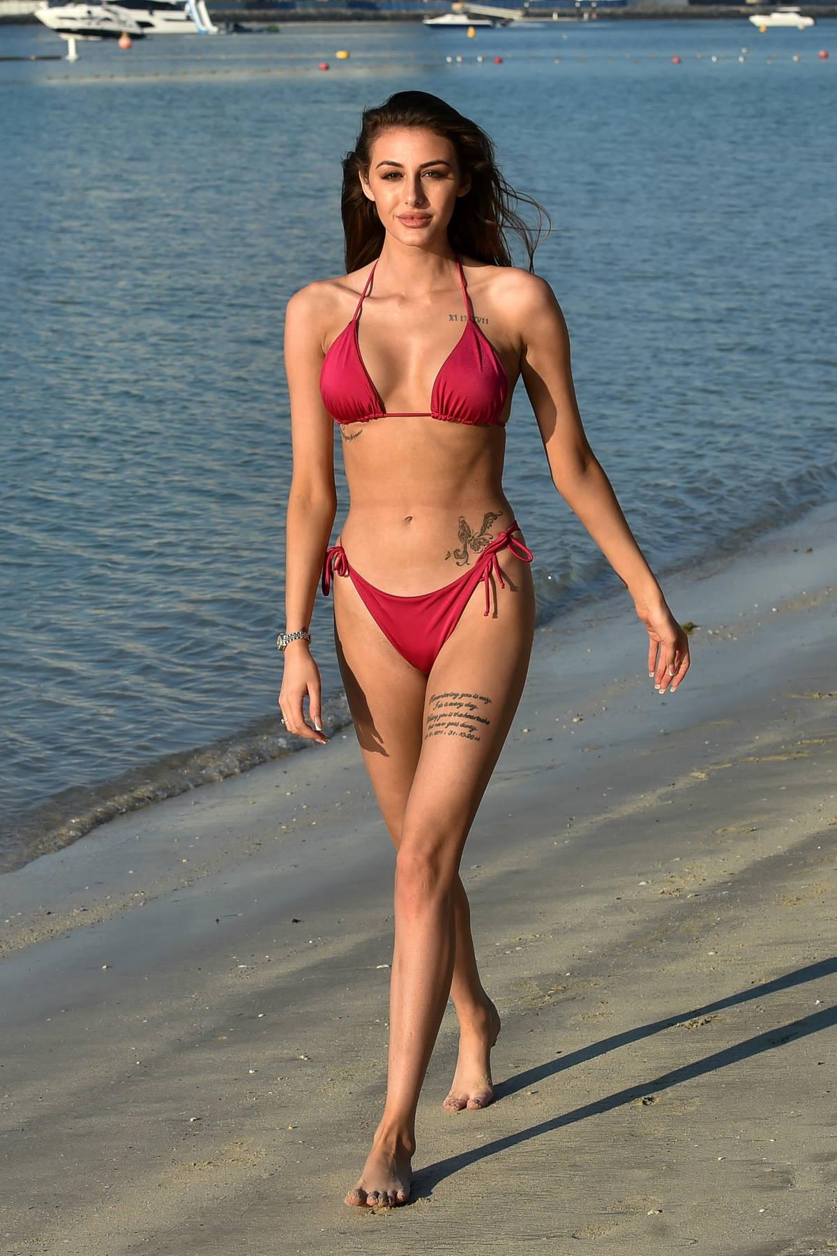 Chloe Veitch puts on a stunning display as she hits the beach in a red bikini in Dubai, UAE
