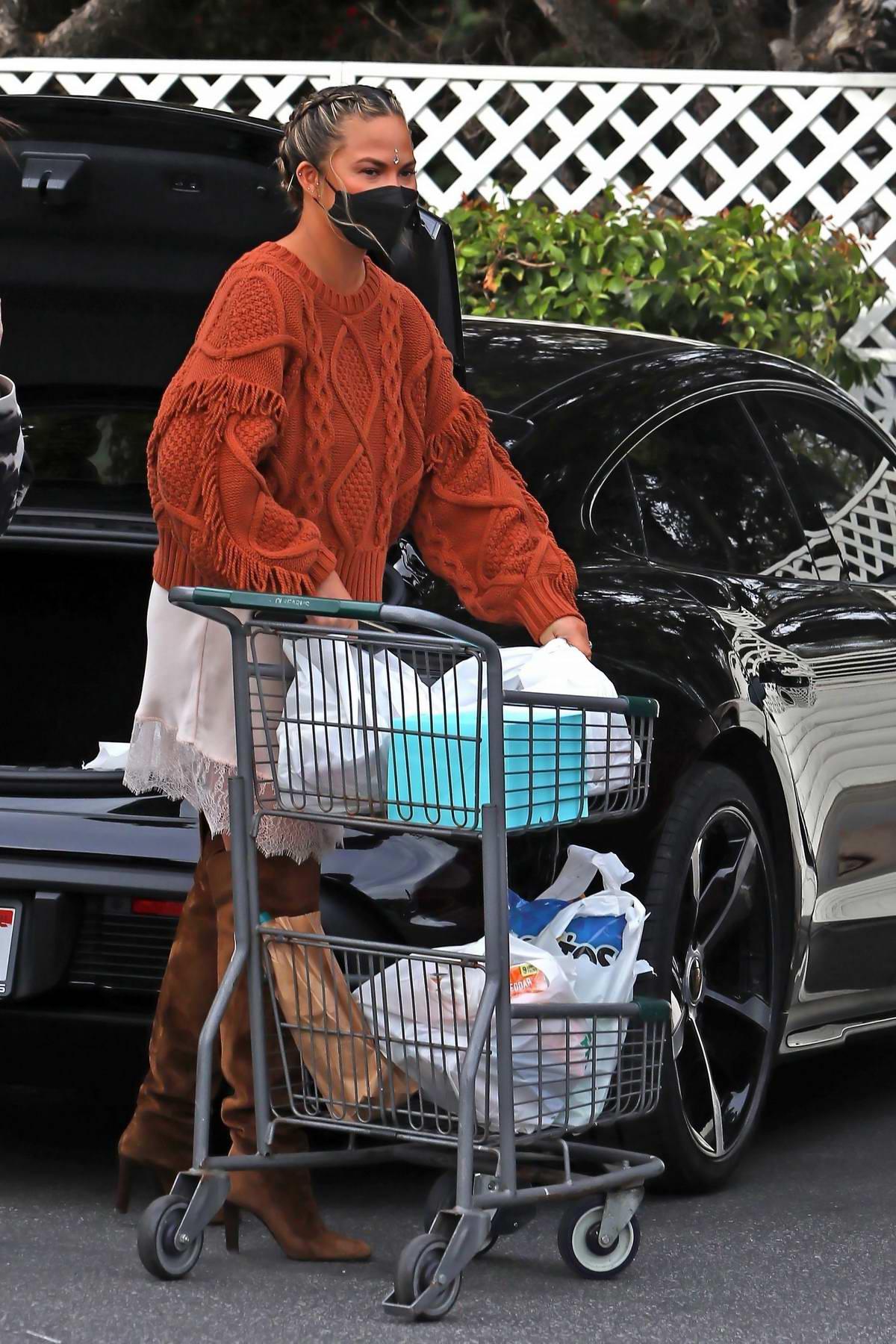 Chrissy Teigen grabs some essentials at Bristol Farms in Beverly Hills, California