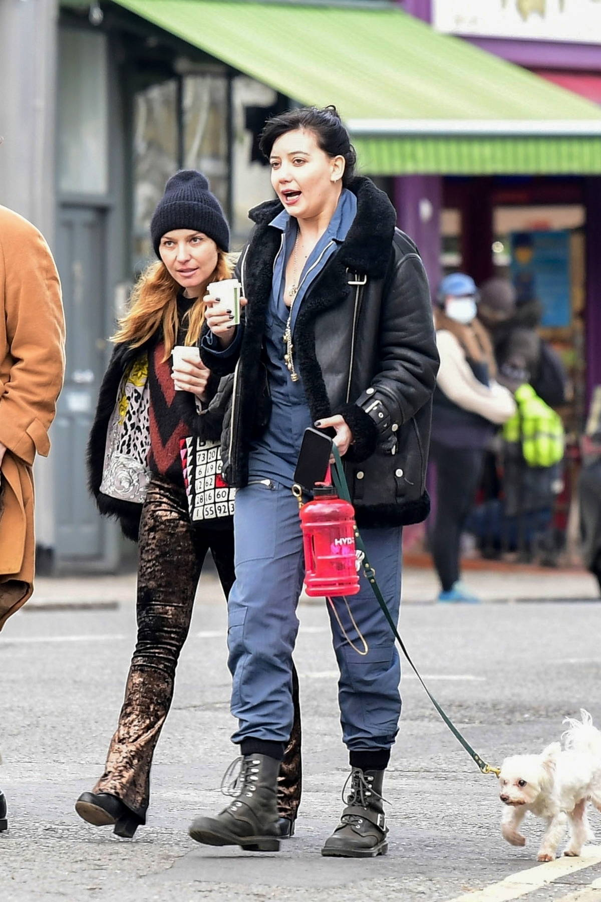 Daisy Lowe takes her cute dog out for a walk and coffee with some friends in North London, UK