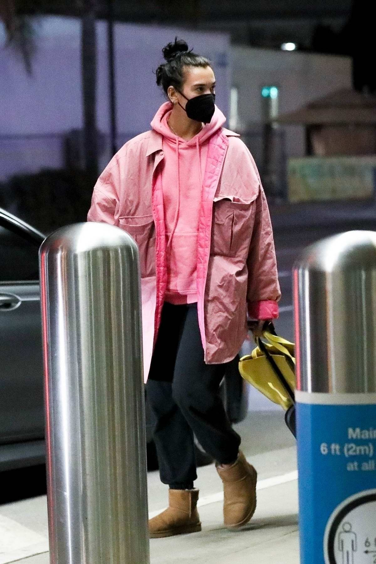 Dua Lipa looks cozy in sweats as she arrives at LAX in Los Angeles