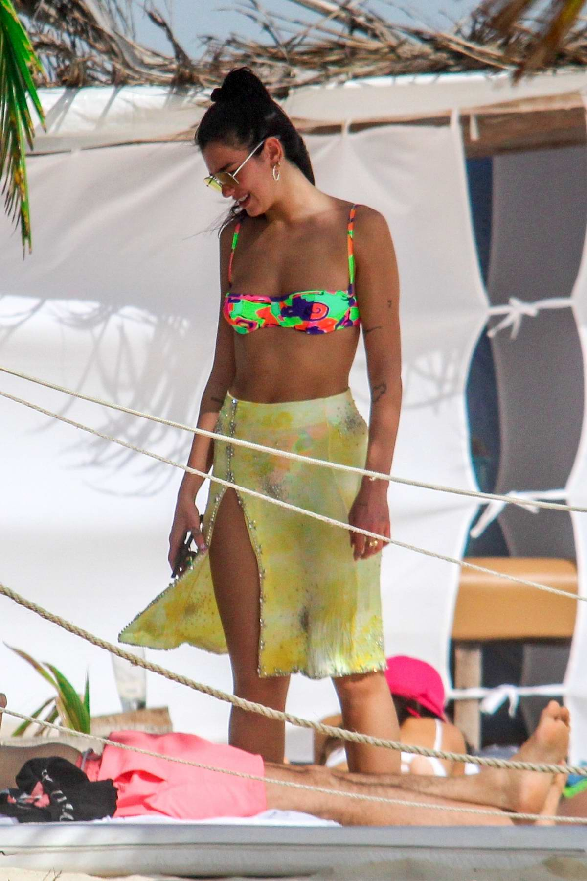 Dua Lipa looks great in a colorful bikini while vacationing in Tulum, Mexico