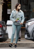 Eiza Gonzalez shows off her svelte figure in teal leggings paired with a denim jacket while out for a green juice in Los Angeles