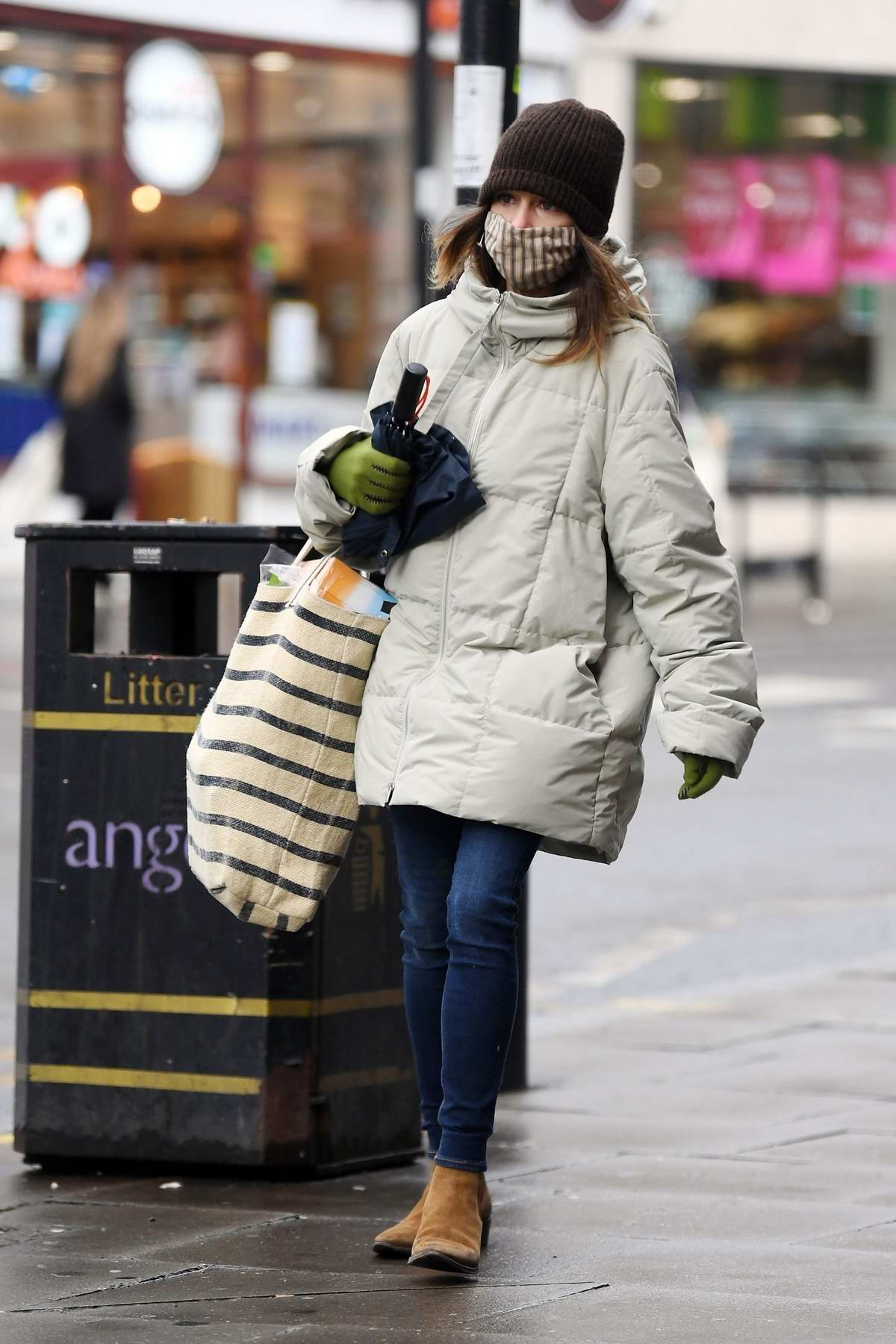 Emilia Clarke braves the cold weather with a puffer jacket and beanie during a shopping trip in London, UK