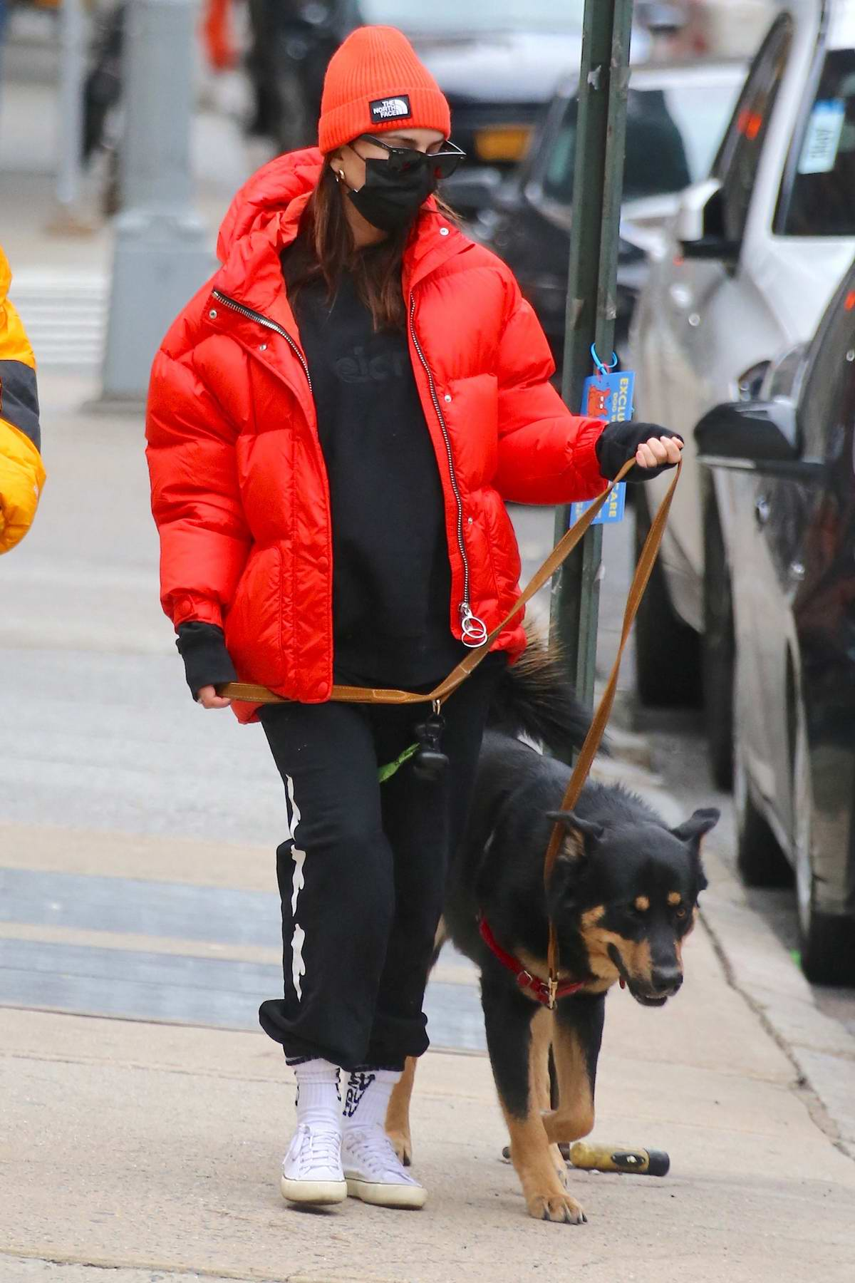 Emily Ratajkowski stands out in bright red puffer jacket while visiting City MD Urgent care in Tribeca, New York City