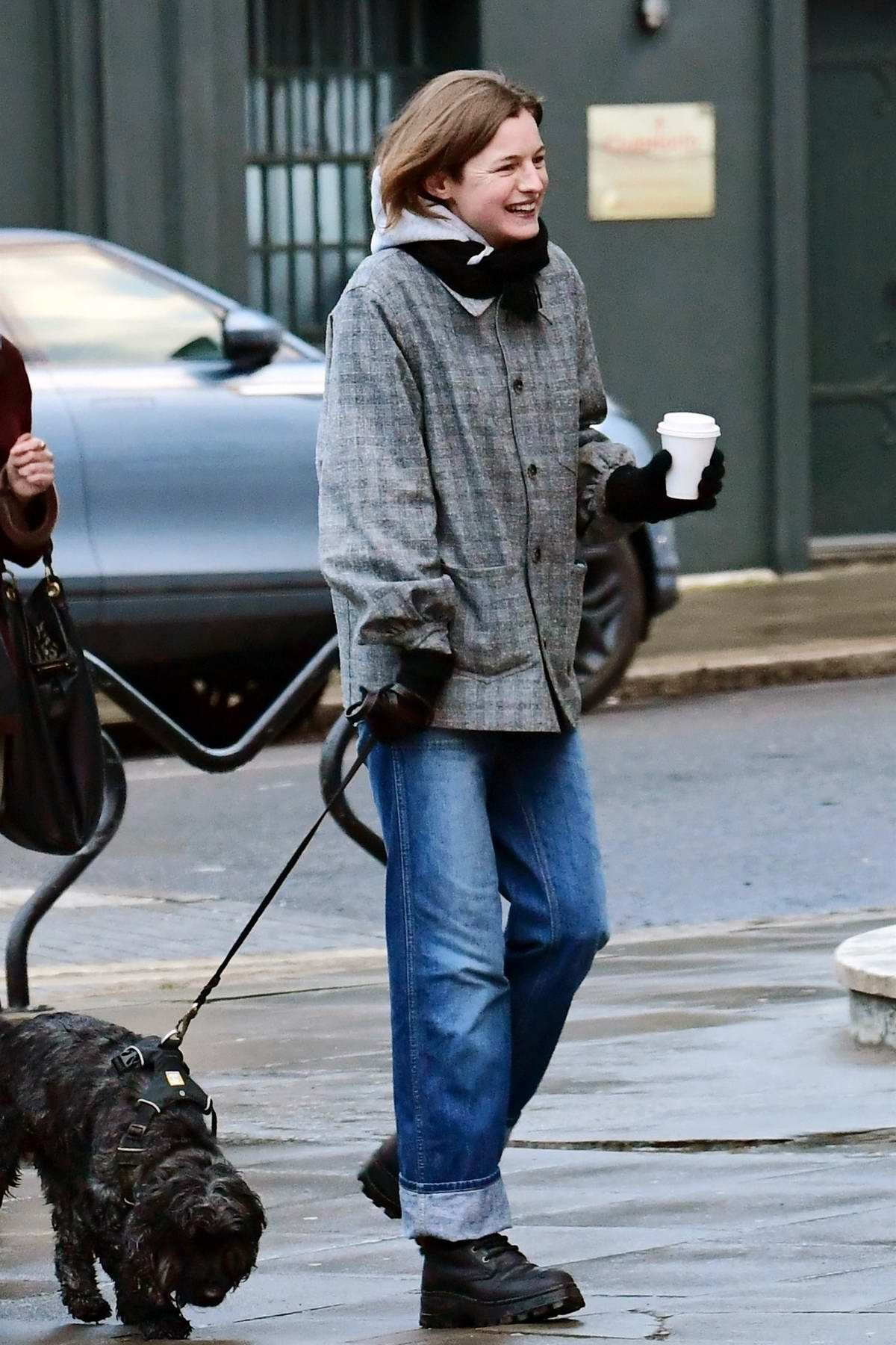 Emma Corrin is all smiles while out walking her dog with friends in Primrose Hill, London, UK