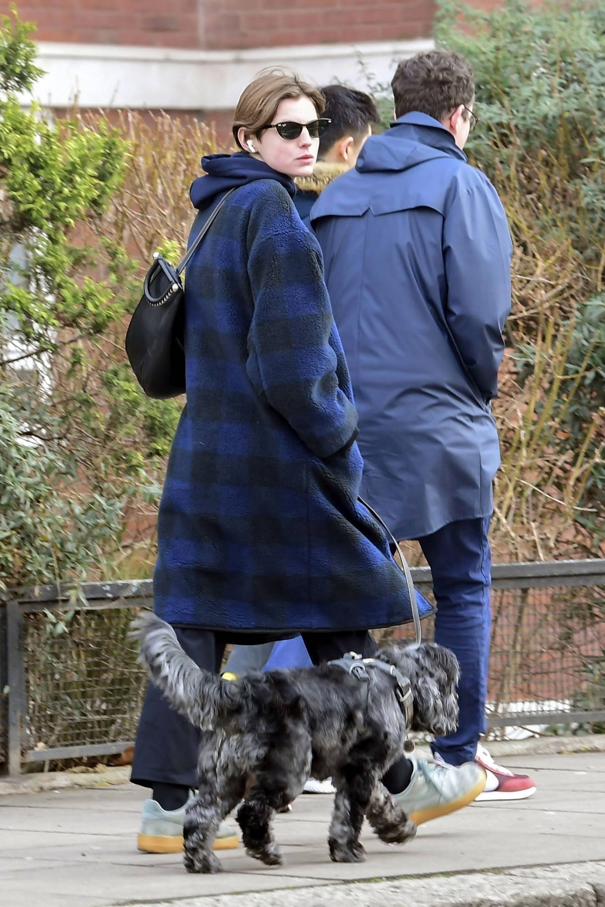 Emma Corrin shows off her laid back casual style while out walking her dog in North London, UK
