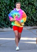 Florence Pugh sports a colorful tie-dye hoodie and bright red bike shorts while out for a run with her dog in Los Angeles