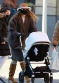 Gigi Hadid goes out for a stroll with her baby daughter after having lunch with a friend in New York City