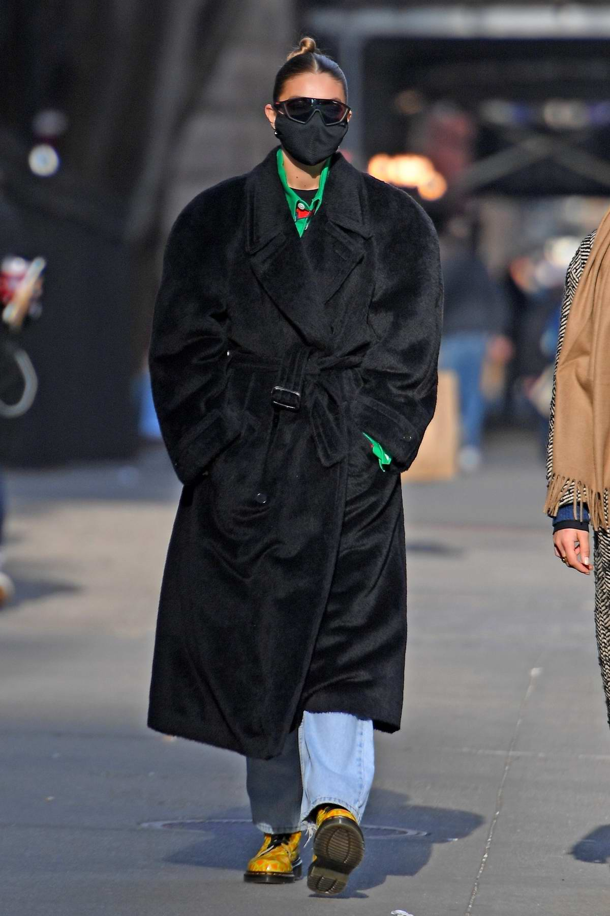 Gigi Hadid keeps warm in a full-length black coat while out for stroll in New York City