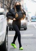 Gigi Hadid sports a black puffer jacket and leggings while out with her baby daughter in SoHo, New York City