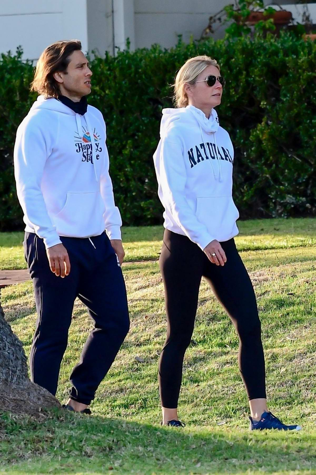Gwyneth Paltrow sports a white hoodie and black leggings for an afternoon walk with Brad Falchuk in Brentwood, California