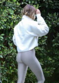 Hailey Bieber displays her curves while arriving at a private gym in Los Angeles