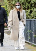 Hailey Bieber is flanked by her security while visiting a friend in Beverly Hills, California