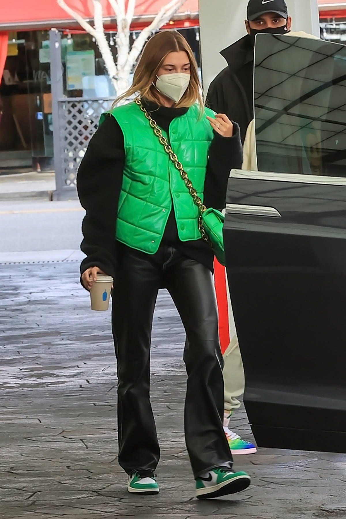 Hailey Bieber looks cool in a green sleeveless jacket while visiting a dermetologist with Justin Bieber in West Hollyood, California