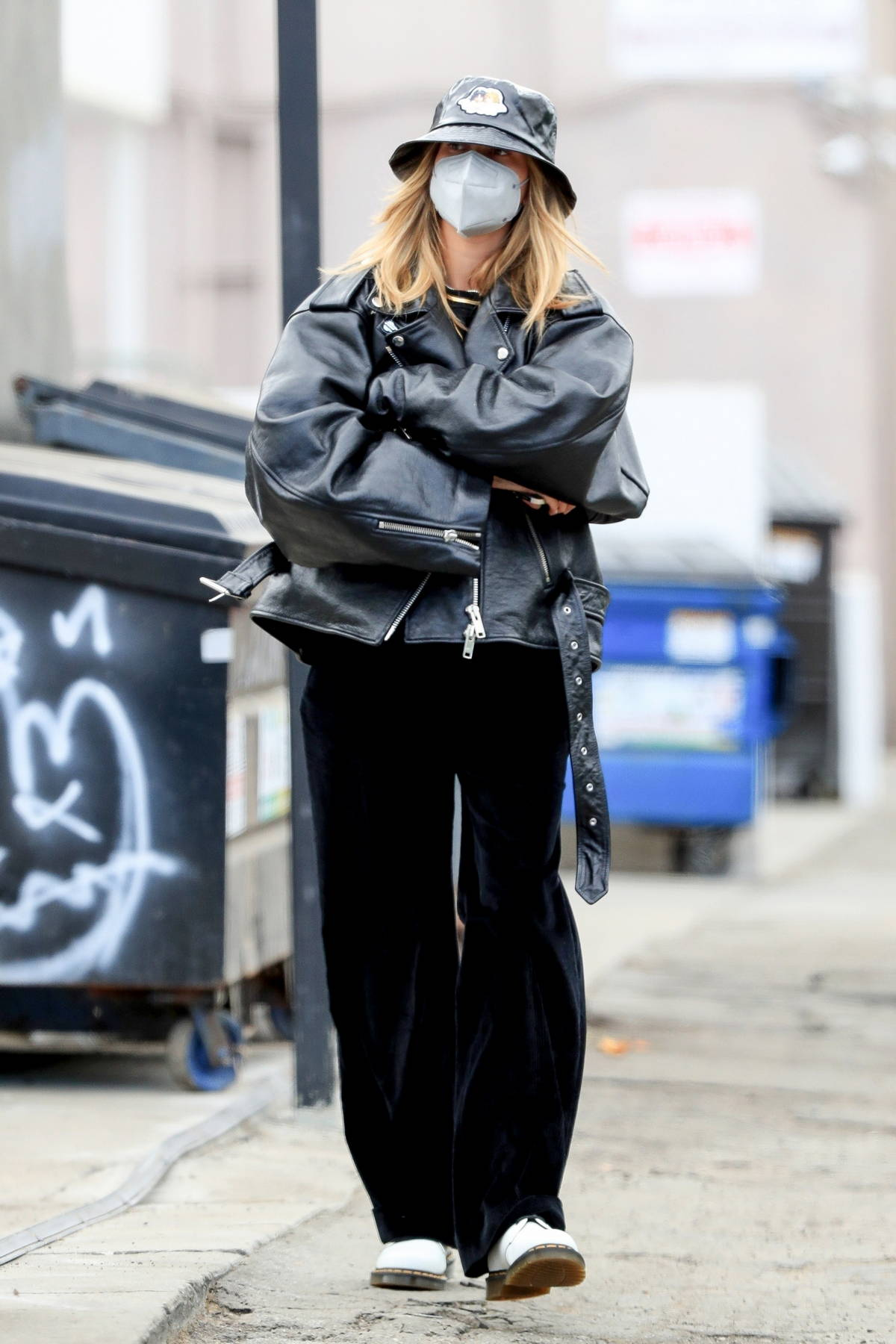 Hailey Bieber looks cool in an oversized leather jacket paired with a black bucket hat while out in West Hollywood, California