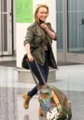Hayden Panettiere looks amazing as she flashes a big smile while making her way through the LAX airport in Los Angeles