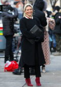 Hilary Duff covers her baby bump underneath a black coat while filming scenes for 'Younger' in Manhattan, New York City
