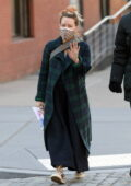 Hilary Duff steps out wearing a plaid coat with a black dress in New York City
