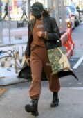 Irina Shayk dons a black leather jacket and brown sweats with a hat while visiting a spa in New York City