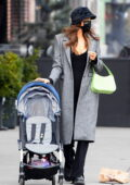 Irina Shayk keeps it stylish with a grey coat over a black jumpsuit while picking up her daughter up from school in New York City