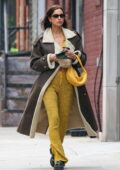 Irina Shayk looks fashionable in a long brown coat with a yellow outfit while out and about in Manhattan, New York City