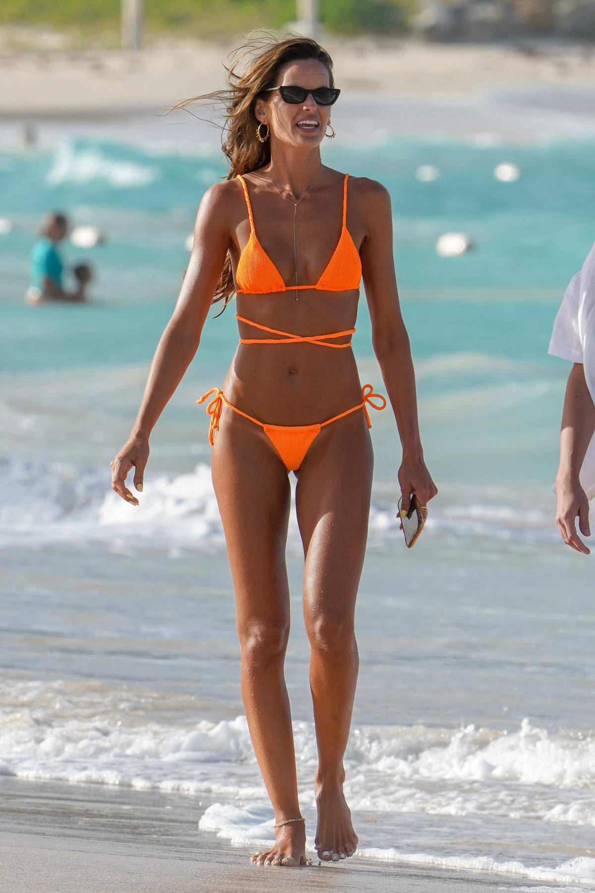 Isabelle Goulard looks sensational in an orange bikini as she hits the Eden Rock hotel beach in St Barth, France