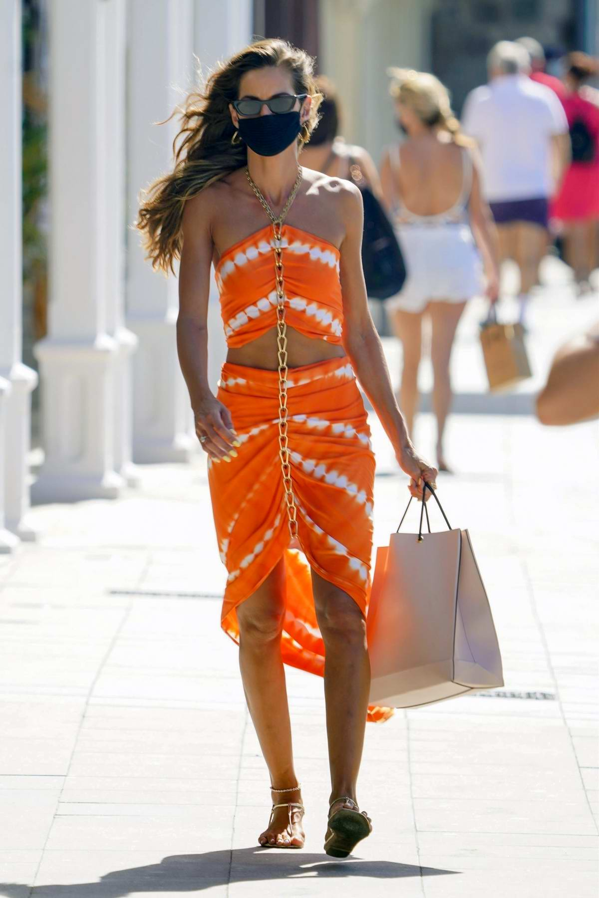 Izabel Goulart looks amazing in an orange outfit while out and about before getting onto a boat in St Barth, France