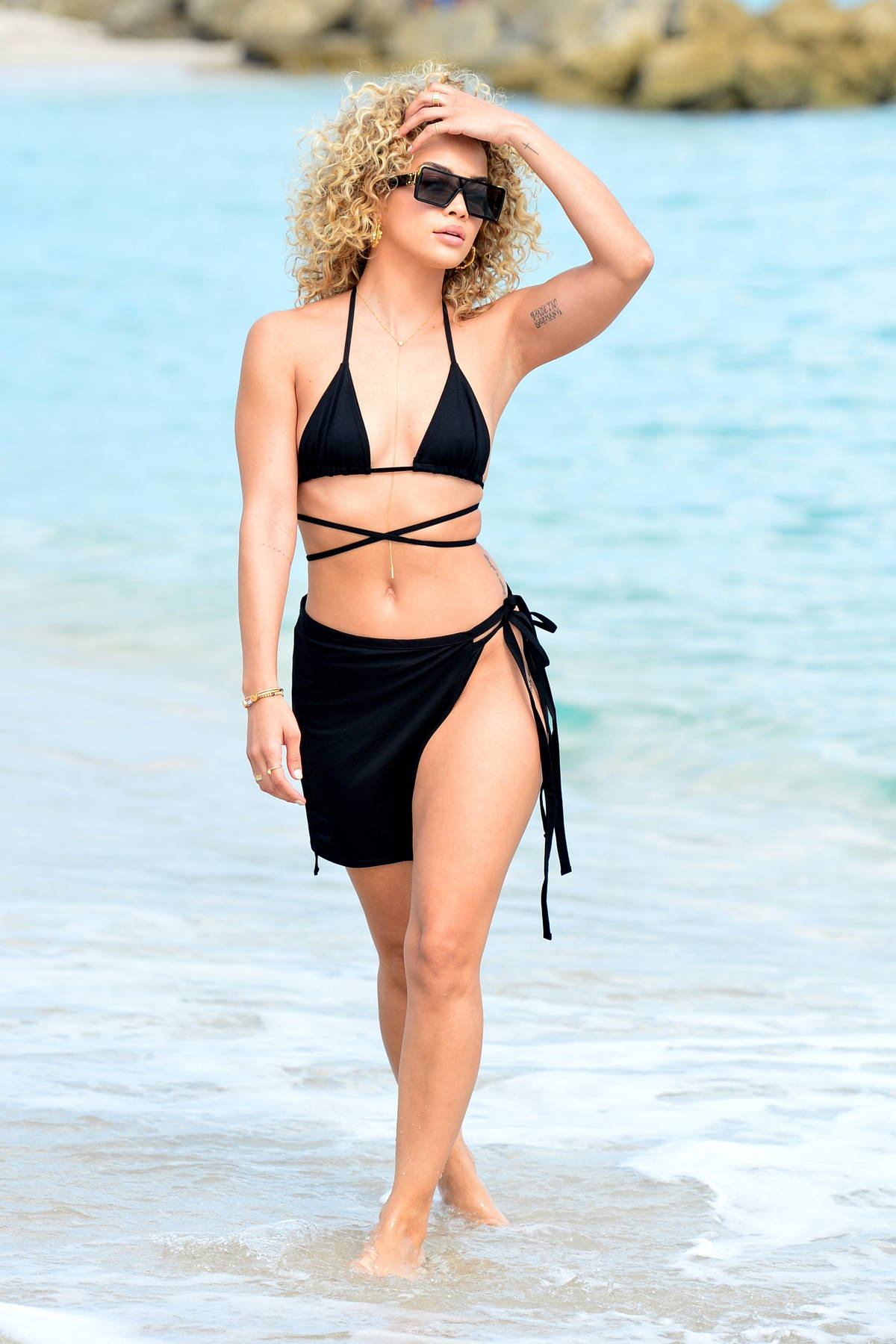Jasmine Sanders looks stunning in a black 'PrettyLittleThing' bikini and black wrap as she hits beach in Miami, Florida