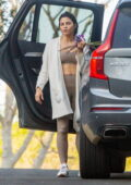Jenna Dewan flashes her abs in a workout top and leggings as she arrives home after a workout session in Los Angeles