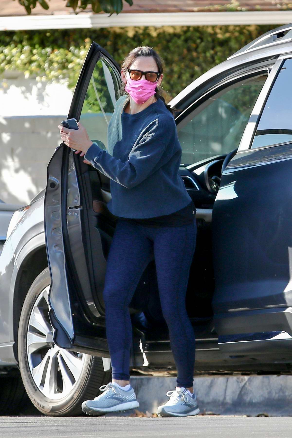 Jennifer Garner shows off her toned legs in navy blue leggings while out for a walk with a friend in Brentwood, California