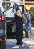 Jennifer Garner waves at the cameras after stopping to check on the progress of her new home in Brentwood, California