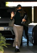 Jennifer Garner waves for the camera as she arrives for a meeting in Brentwood, California