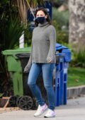 Jennifer Garner wears a grey sweater and jeans while out for a walk around her neighborhood in Brentwood, California
