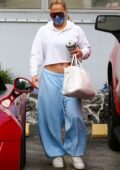 Jennifer Lopez flashes her midriff in a cropped hoodie as she hits the gym before grabbing lunch with friends in Miami, Florida