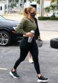 Jennifer Lopez flaunts her curves in a cropped sweatshirt and leggings as she hits the gym in Miami, Florida