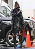 Jennifer Lopez seen wearing a black trench coat as she arrives for a photoshoot on a rainy day in Paramount, California