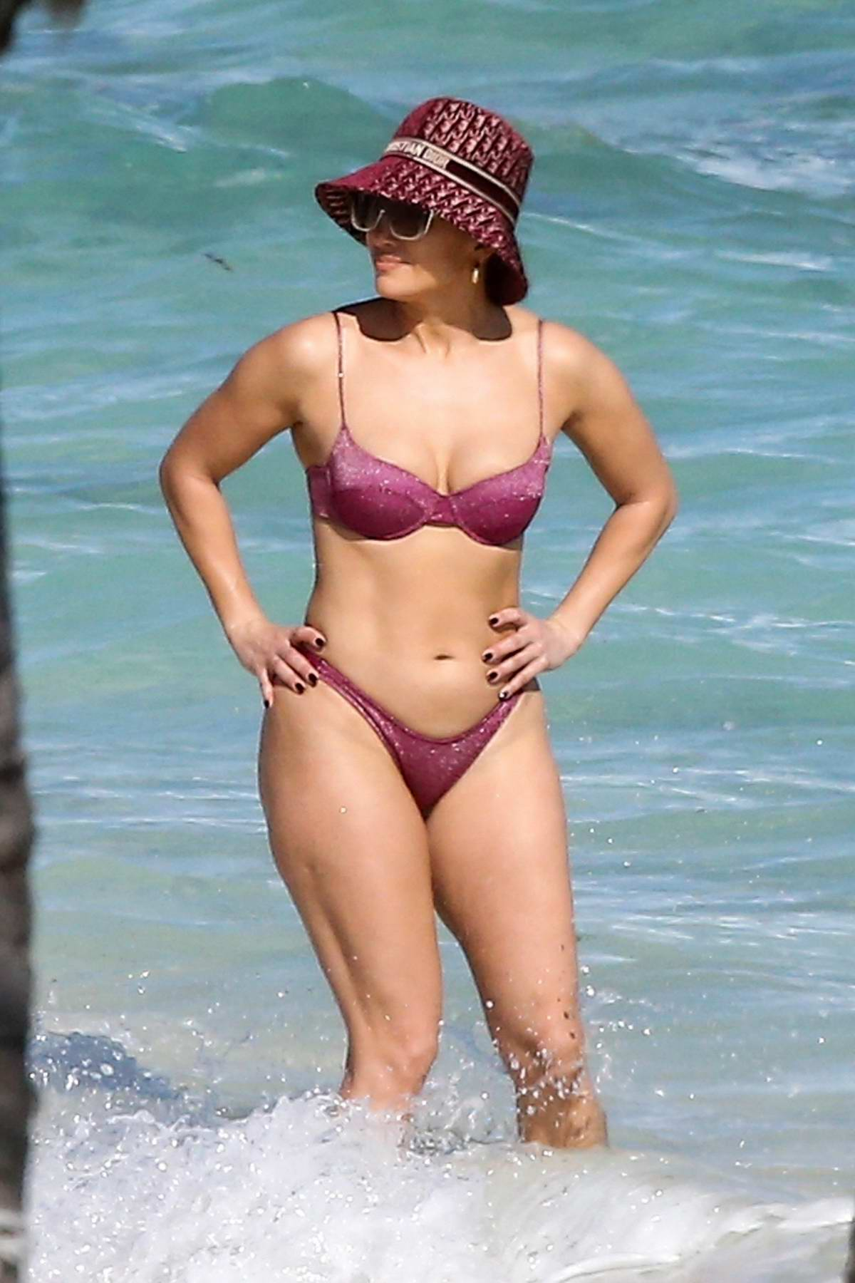Jennifer Lopez shows off her incredible figure in a pink bikini while vacationing in Turks and Caicos