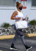 Jennifer Lopez sports a white crop top and patterned leggings as she arrives at the gym in Miami, Florida