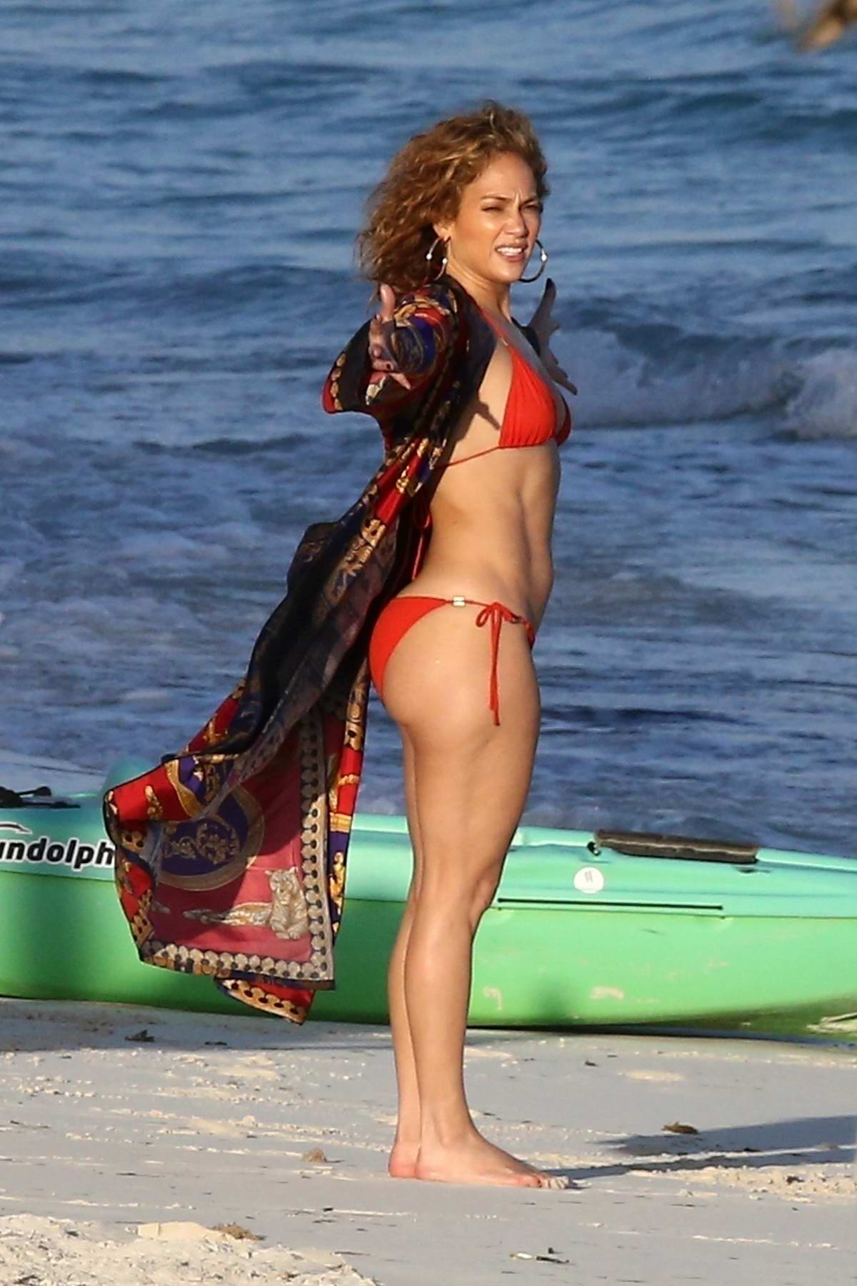 Jennifer Lopez stuns in a red bikini while enjoying the beach in Turks and Caicos