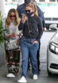 Jennifer Lopez wears a dark grey sweatshirt and jeans for a lunch outing with friends in Miami, Florida