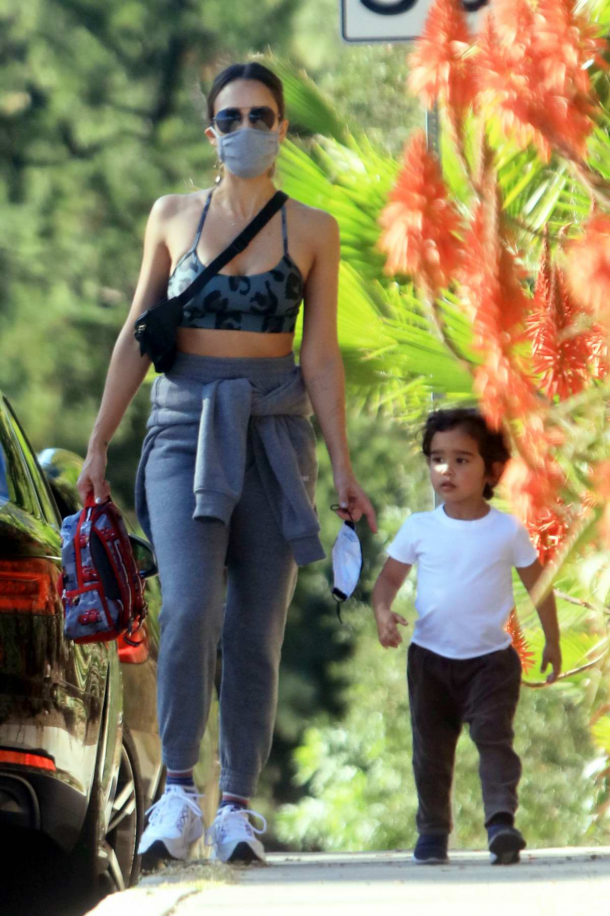 Jessica Alba shows off her toned figure in sports bra and sweatpants while strolling with her kids in Los Angeles