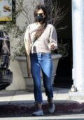Jordana Brewster steps out on a windy day for a fresh baguette and coffee at Kreation Organic in Santa Monica, California