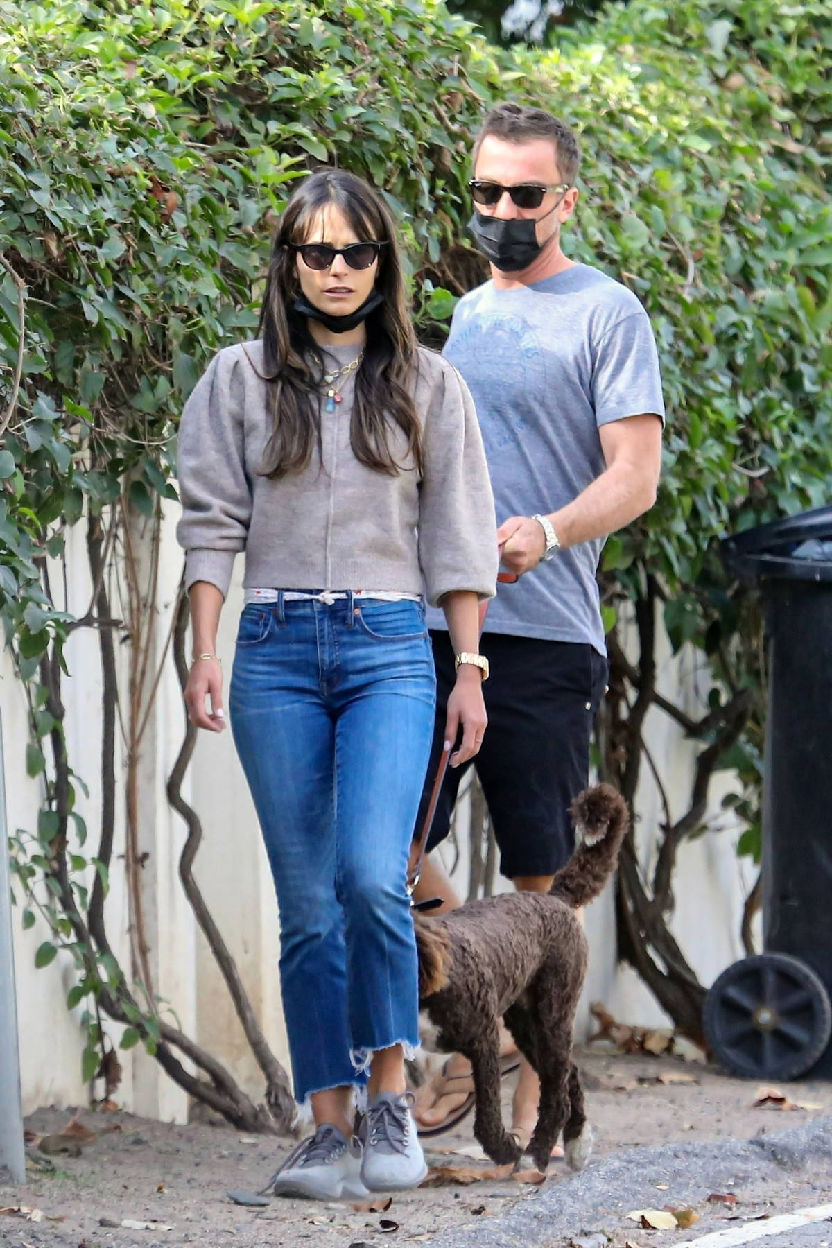Jordana Brewster takes her puppy out for a walk with boyfriend Mason Morfit in Brentwood, California