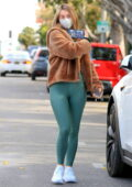 Julianne Hough takes a Zoom call while out sporting a brown teddy coat and teal green leggings in Los Angeles