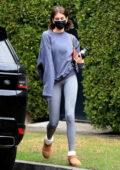 Kaia Gerber displays her slender legs in grey leggings as she leaves the gym in West Hollywood, California