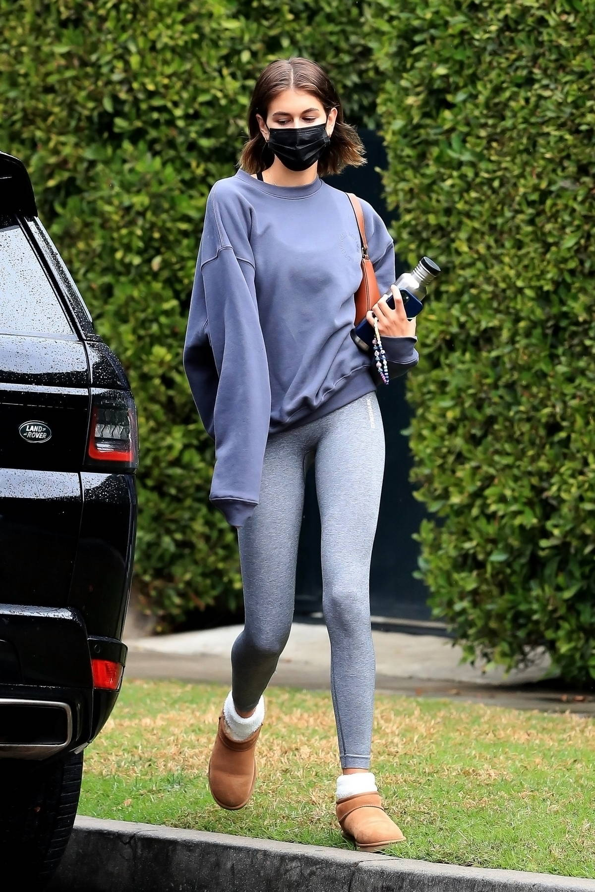Kaia Gerber displays her slender legs in grey leggings as she leaves the gym in West Hollywood, California