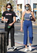 Kaia Gerber sports a crop top and high-rise blue pants while making a coffee run with a friend at Starbucks in Malibu, California