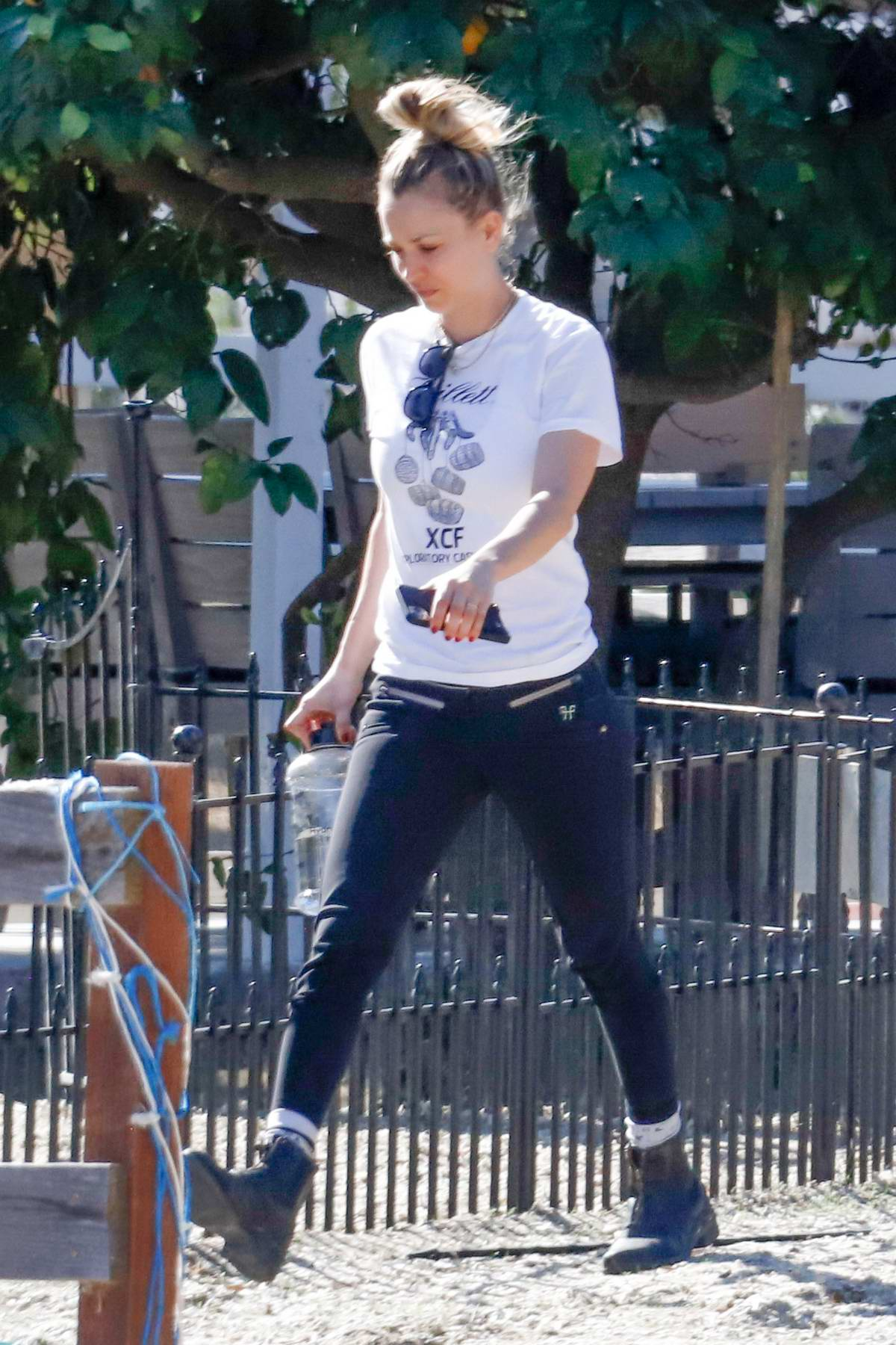 Kaley Cuoco keeps it casual with a white tee and black leggings as she steps out to walk her dog in Los Angeles