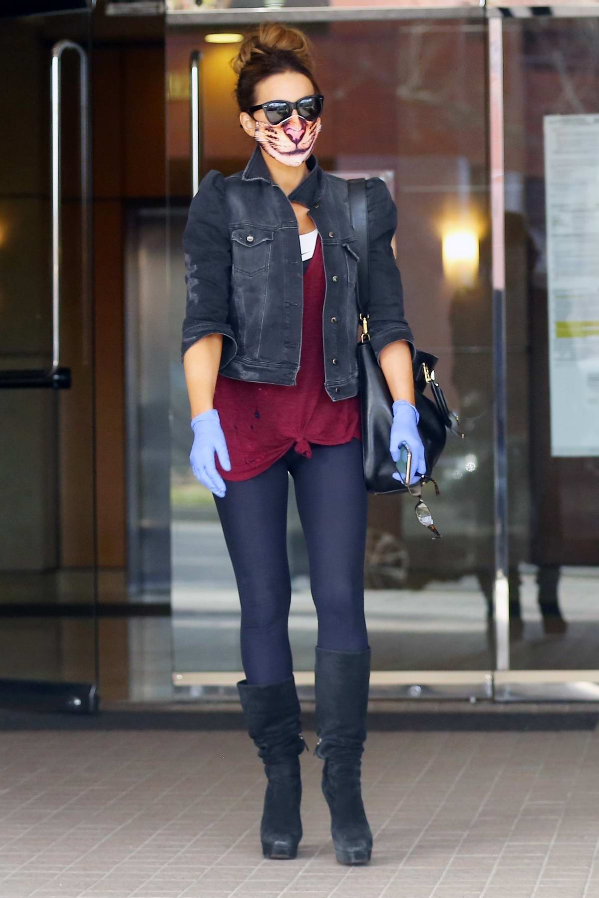 Kate Beckinsale wears feline face mask and latex gloves while running errands in Brentwood, California