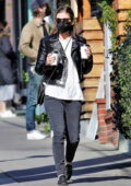 Kate Mara cuts a casual figure in black jeans and a leather jacket while making a coffee run in Los Feliz, California